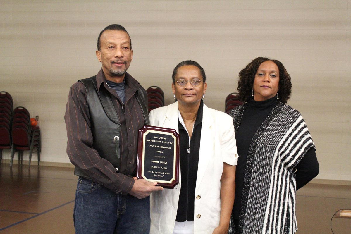 Calvin Nicely receives the posthumously awarded 2016 Dr. Martin Luther King, Jr. Community Award for Advancing Cultural on Awareness on behalf of his brother, Sammie Nicely.