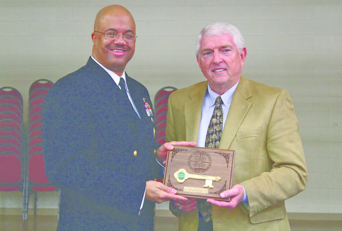 Force Master Chief Mitchell receives a key to the city from Mayor Gary Chesney. Photo by Chuck Hale, published by the Citizen Tribune on January 18, 2016